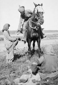 An Indian soldier on horseback giving away his rations to a poor starving girl in Mesopotamia. (Source: Imperial War Memorial)