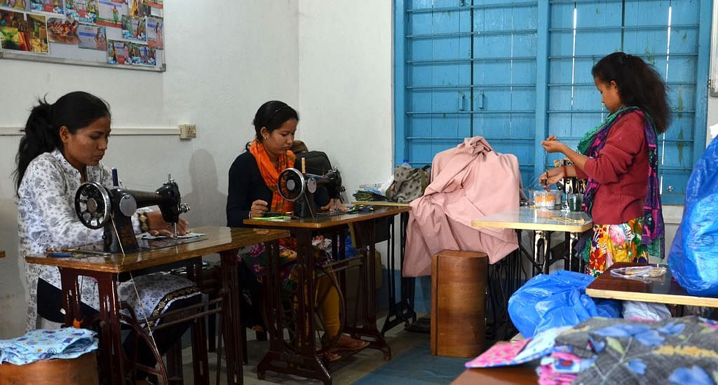 Young girls stitch reusable cotton pads, earning a livelihood. (Photo by Abdul Gani)