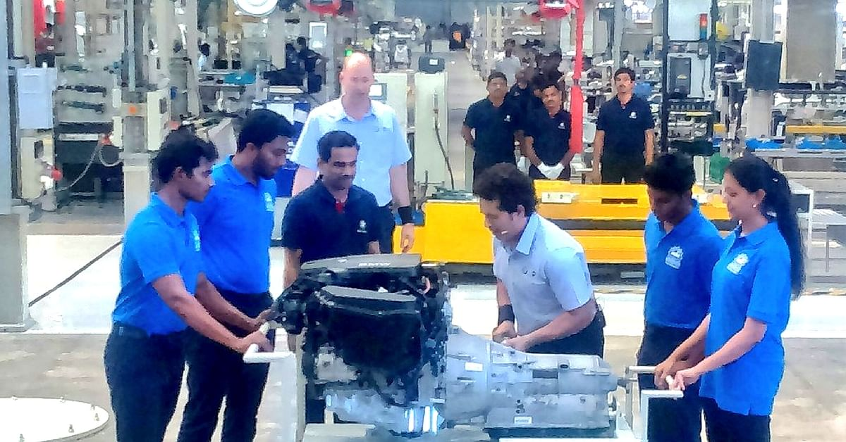 "Sachin at the BMW plant, guiding students and assisting in engine assembly. Image Courtesy: <a href=""https://twitter.com/search?q=%23SkillNext&src=tren"">Twitter</a>"