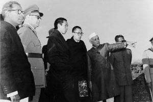 Prime Minister Nehru pointing out a landmark to HH The Dalai Lama and the Panchen Lama. (Source: dalailama.com)