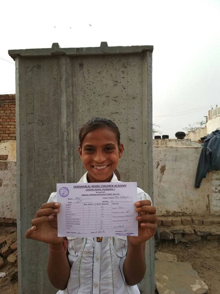 10-year-old Anji with her school certificate.