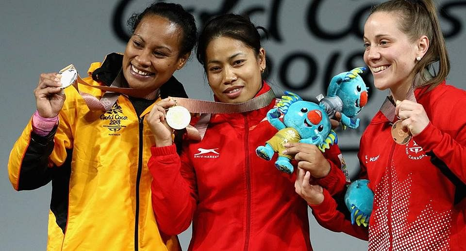 Sanjita Chanu standing with her gold medal in the centre. (Source: Facebook/DD)