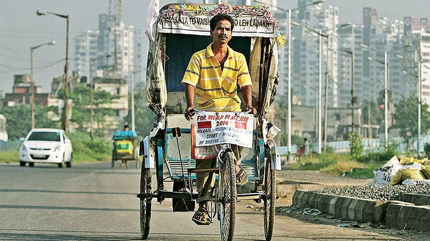 Satyen Das on his cycle rickshaw. (Source: Facebook)