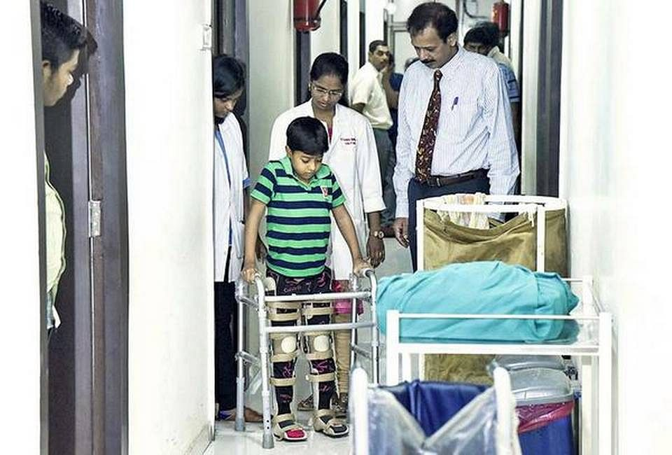 Eight-year-old Rohit Gehlot walking with support. (Source: Facebook/Adigos Stem Cells)
