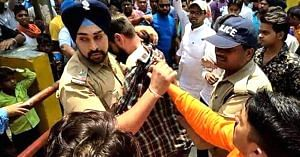 In the line of duty. Sub-Inspector Gangandeep shielding a Muslim man. (Source; YouTube)