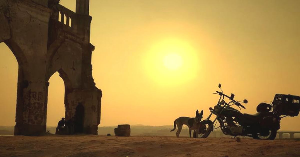 Gowtham's trusty motorcycle, and his best friend, catch the sunset, somewhere in Karnataka. Image Courtesy: Gowtham