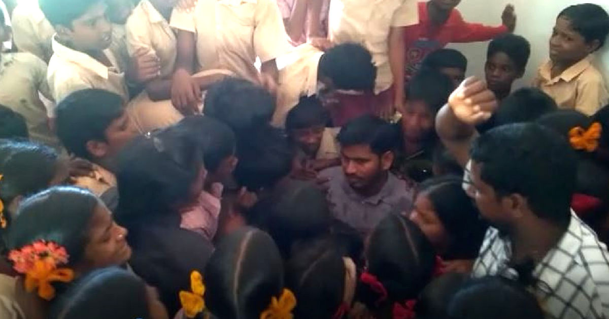 Teacher G Bhagawan surrounded by his emotional students.