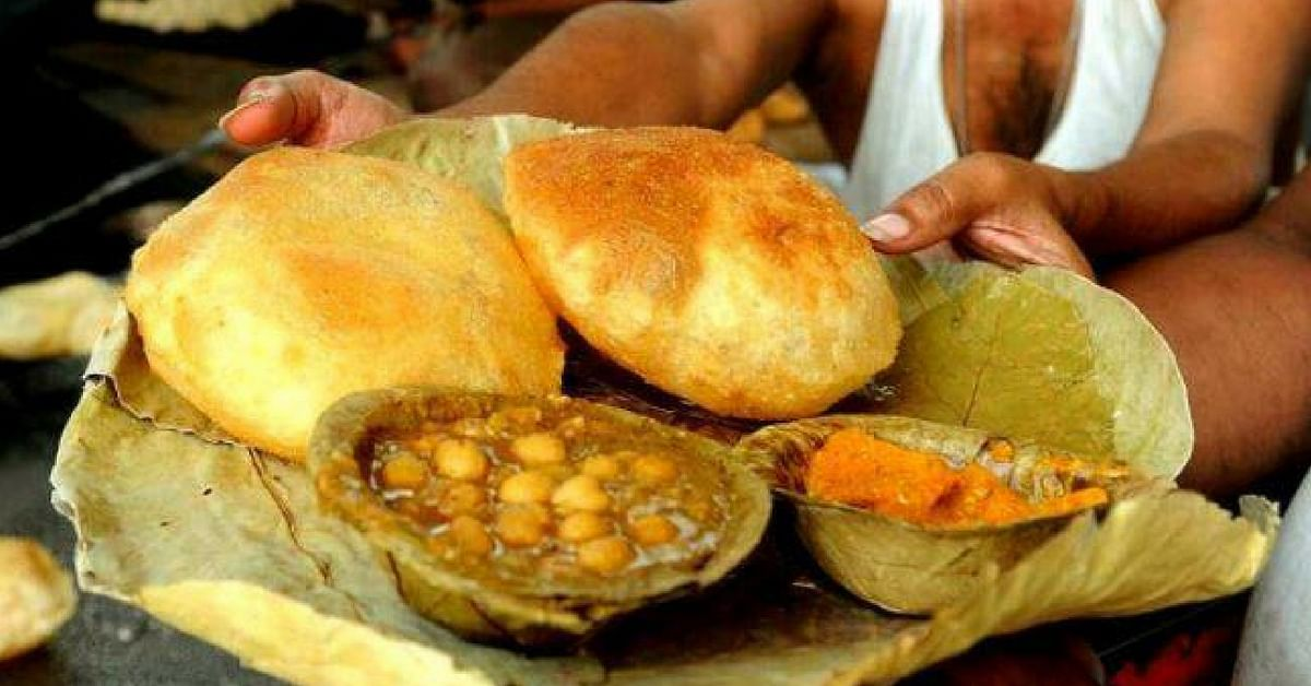 Dig into luchi aloo on the streets of Kolkata. Image Credit: Talking Street
