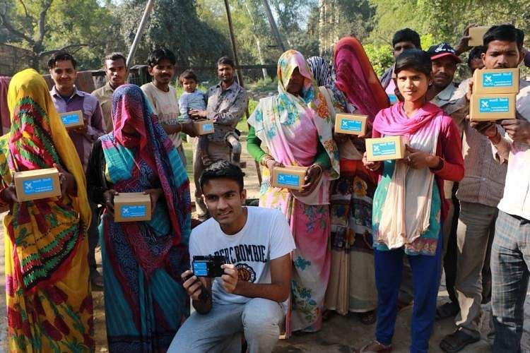 Ishan Malhotra posing with fellow villagers with his Pluto device. (Source: Ishan Malhotra)
