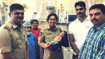 cops rescue 6-day-old baby