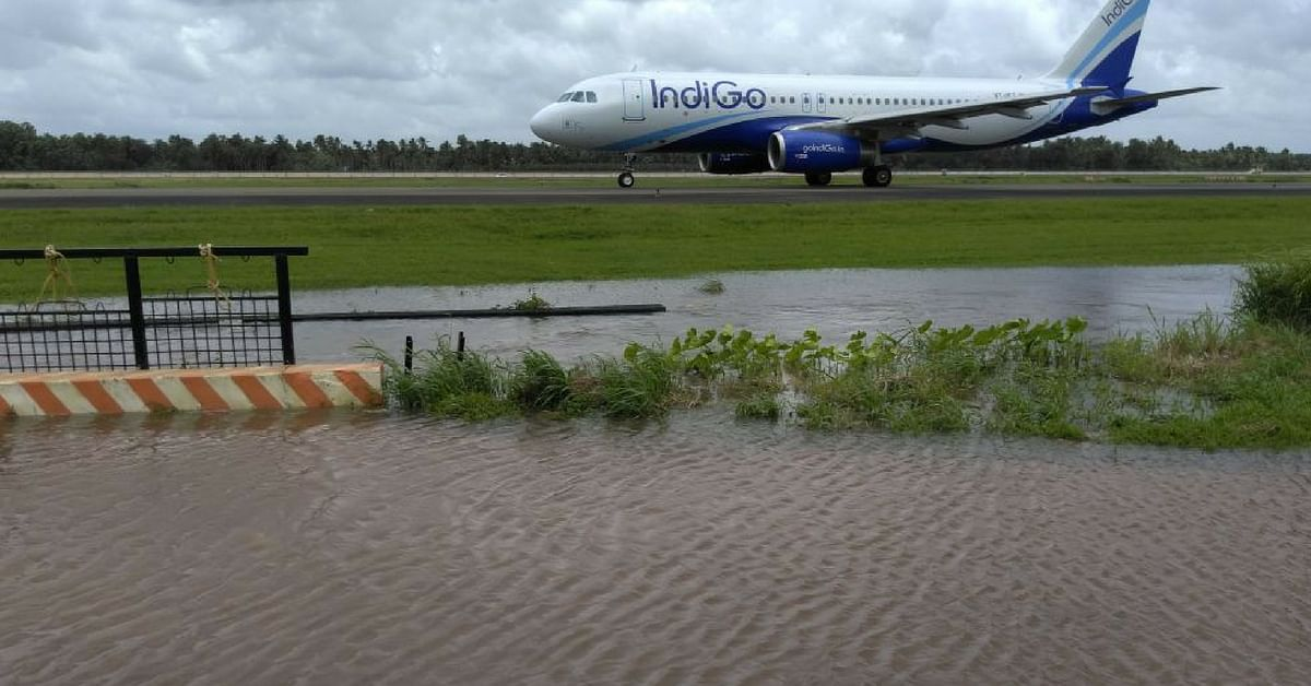 A plane stands stranded on a runway in Kerala. Image Credit: Santhosh