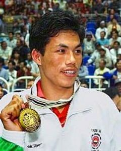 Dingko Singh with his Asian Games gold. (Source: Facebook/The Voice of North East India)