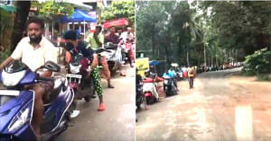 Long line of locals waiting to fill their petrol tank. (Source: Still from the Video Below)