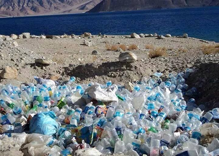 Plastic bottles strewn around near the Pangong Tso Lake. (Source: Facebook/Arch Riders)