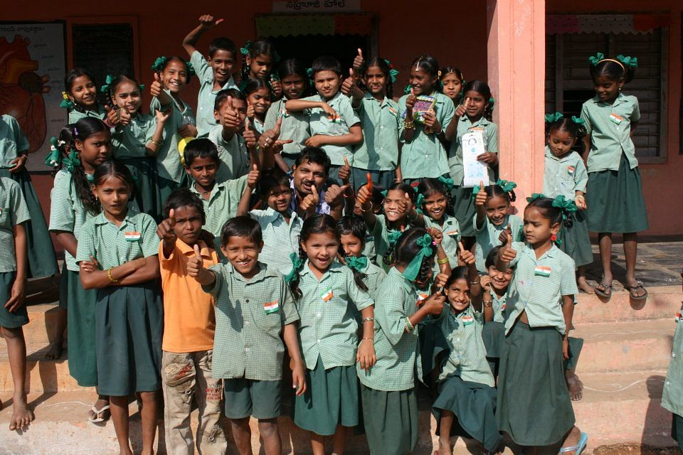 Sridhar Reddy celebrating Republic Day with children from a government school in his hometown in 2012.
