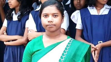 Rumpa, a student of a school in a village near Kolkata, jumped into a pond to save a 3 year old child. Image credit: Aritra Maity.