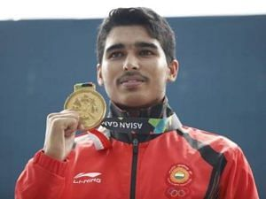 from humble beginnings: Saurabh Chaudhary standing tall with his shooting gold. (Source: Facebook)