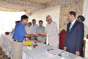 Sonam Lotus receiving a Letter of Appreciation from NN Vohra, the former Governor of J&K at Raj Bhavan, Srinagar in August 2012. (Source: Facebook/Sonam Lotus)