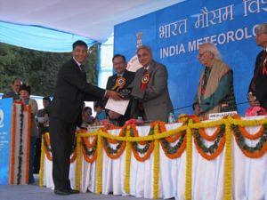 Receiving the Best Employee Award of IMD for 2009-10. (Source: Facebook/Sonam Lotus)