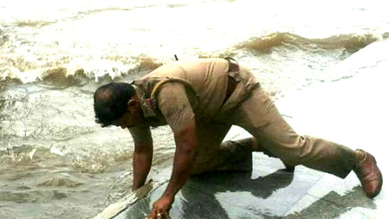 The cop in Coimbatore swam through flooded waters to reach the distressed. Image Credit: Karthik