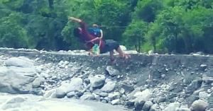 Jodh Singh rappling on a zip-line. (Source: Video still from YouTube)