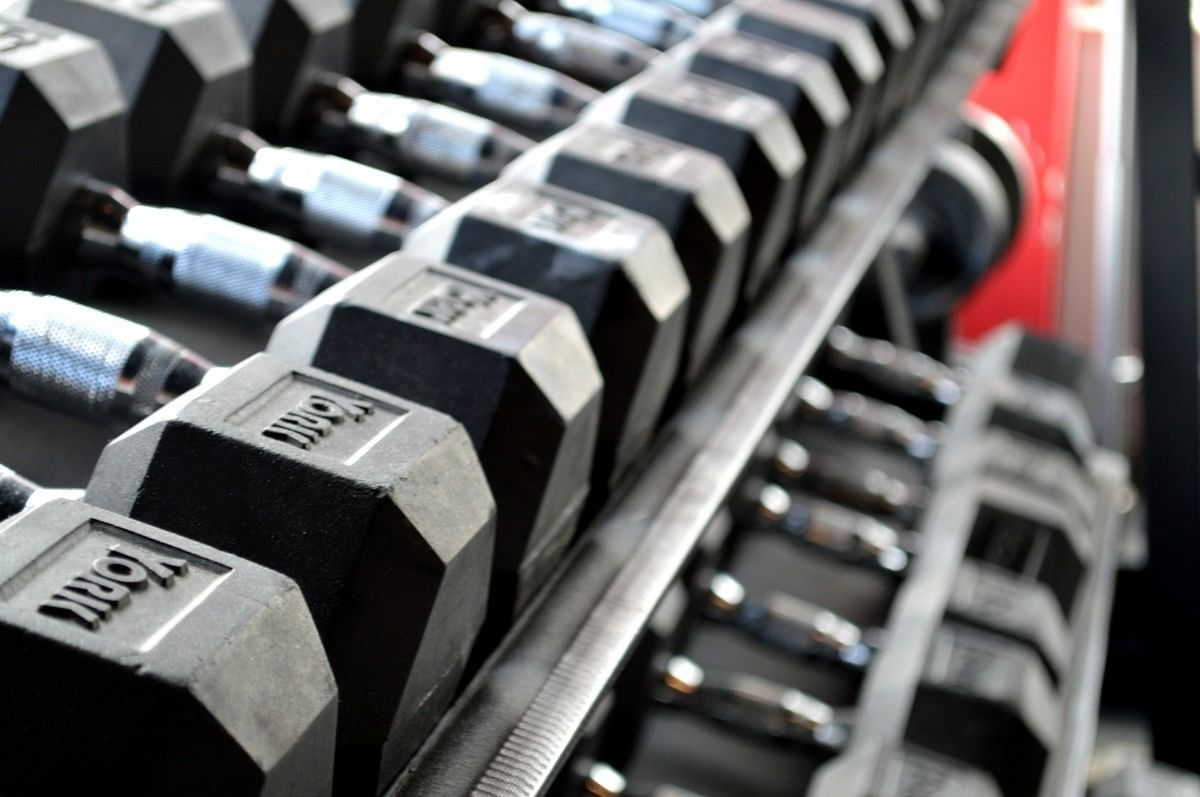 fitness weight lifting dumbbells exercise gym