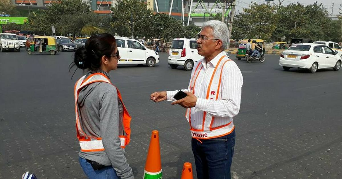 Here's Why This 57-YO Businessman Directs Traffic in Gurugram's Choked Streets
