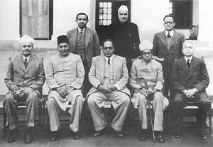 (Sitting from left) N. Madhavrao, Sayyad Sadulla, BR Ambedkar (Chairman), Alladi Krishnaswamy Iyer, Sir Benegal, Narsingh Rao. Standing from left – S.N. Mukharjee, Jugal Kishor Khanna & Kewal Krishnan. (Source: Twitter/Prashant Shrivastava)