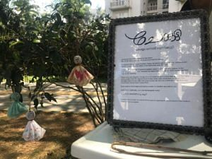 Chekutty doll and a plaque stating the objectives of this initiative. (Source: Facebook/Chekutty)