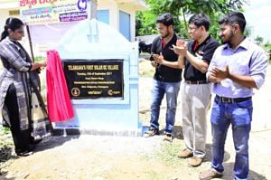 Unveiling a stone plaque at Kesya Thanda village in Devarakonda Mandal, Nalgonda district, Telangana, marking the launch of Solar DC project. Source: Facebook.
