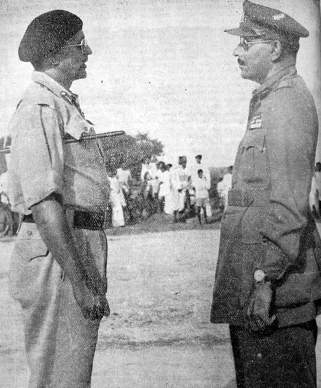 Major General Syed Ahmed El Edroos (at right) offers his surrender of the Hyderabad State Forces to Major General (later General and Army Chief) Joyanto Nath Chaudhuri at Secunderabad. (Source: Wikimedia Commons)