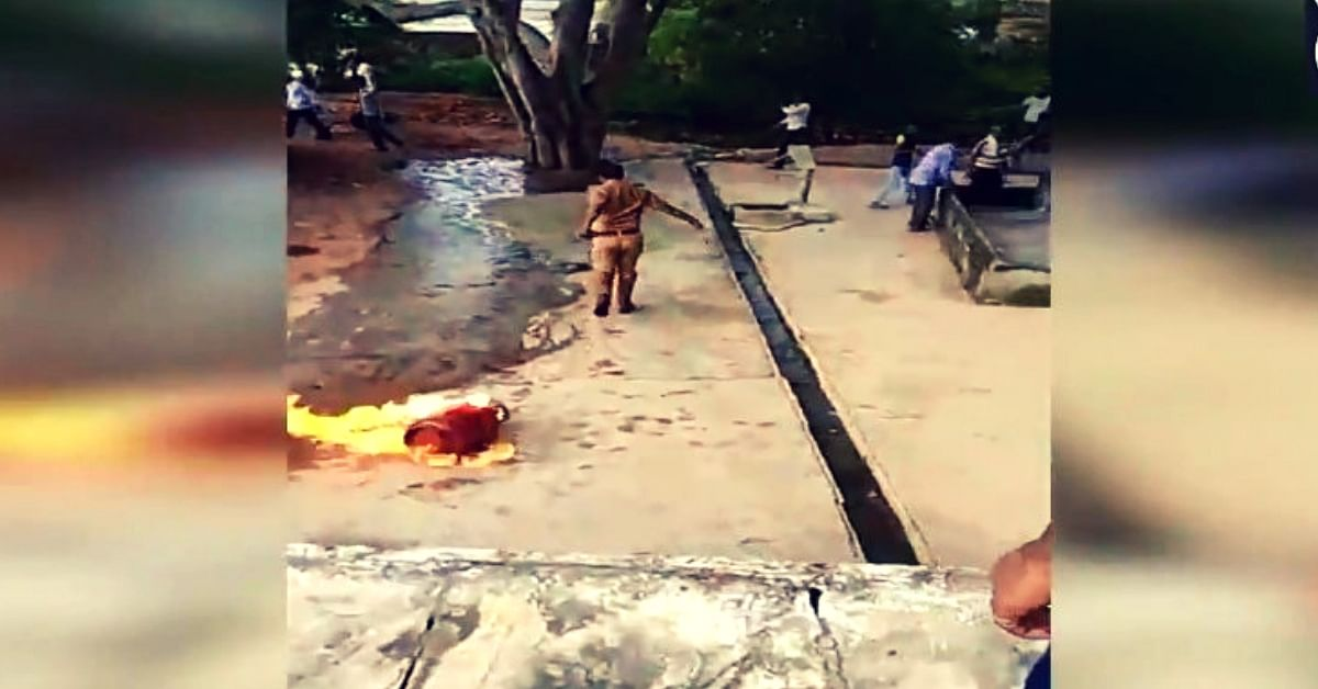 Watch: Brave UP Cop Drags Blazing Cylinder to Pond, Averts Major Tragedy!