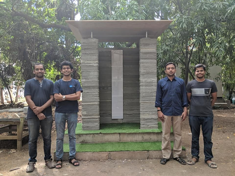 The team behind this latest breakthrough standing in front a structure they constructed using 3D printing construction technology. (Source: Facebook/SK)