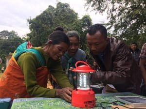 Locals learning how to operate a solar lantern.
