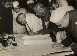 Home Minister Sardar Patel signing the Constitution on January 26, 1950. (Source: Twitter)