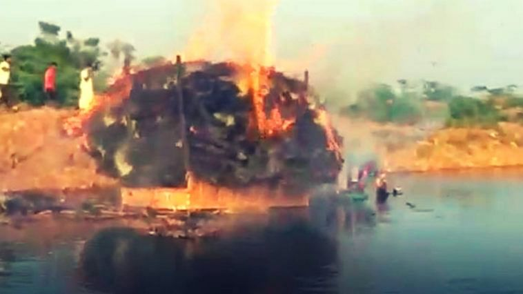 A still from the video shot by locals on the burning tractor in a village lake.