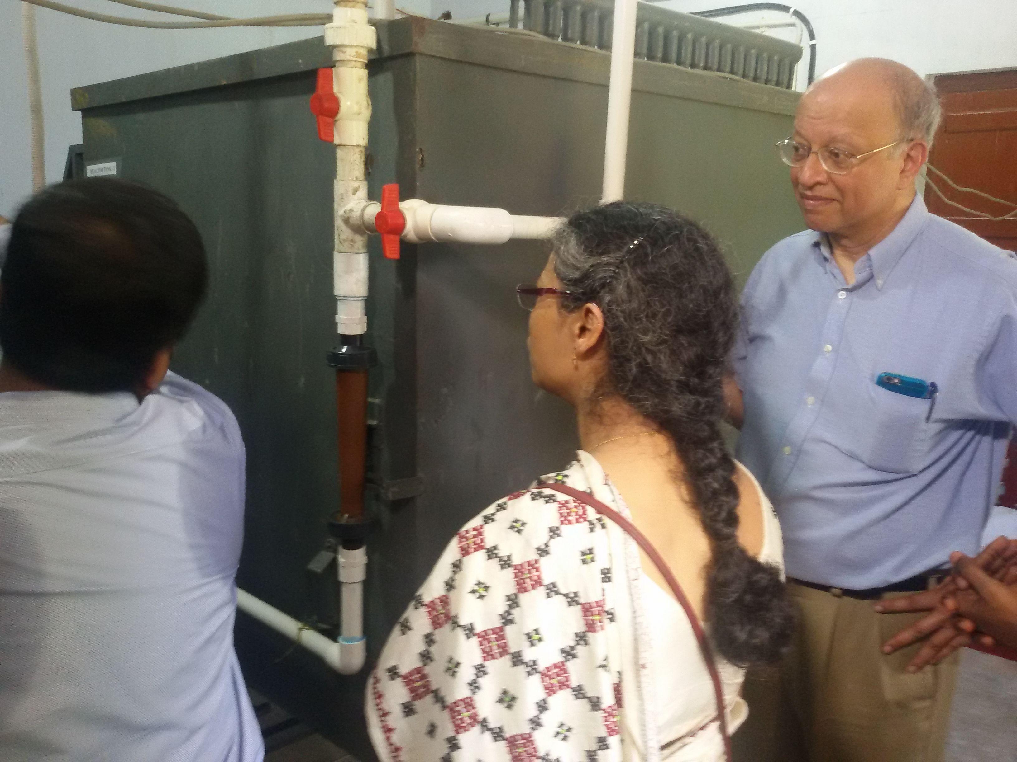 Professor Ashok Gadgil & Professor Joyashree Roy inspecting the reactor tank.