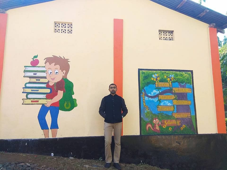 SDO Swapnil Tembe standing outside the renovated school.