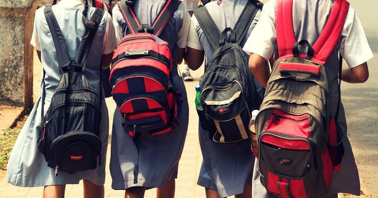 Children weighed down by school bags. It's only a symptom to the real problem.