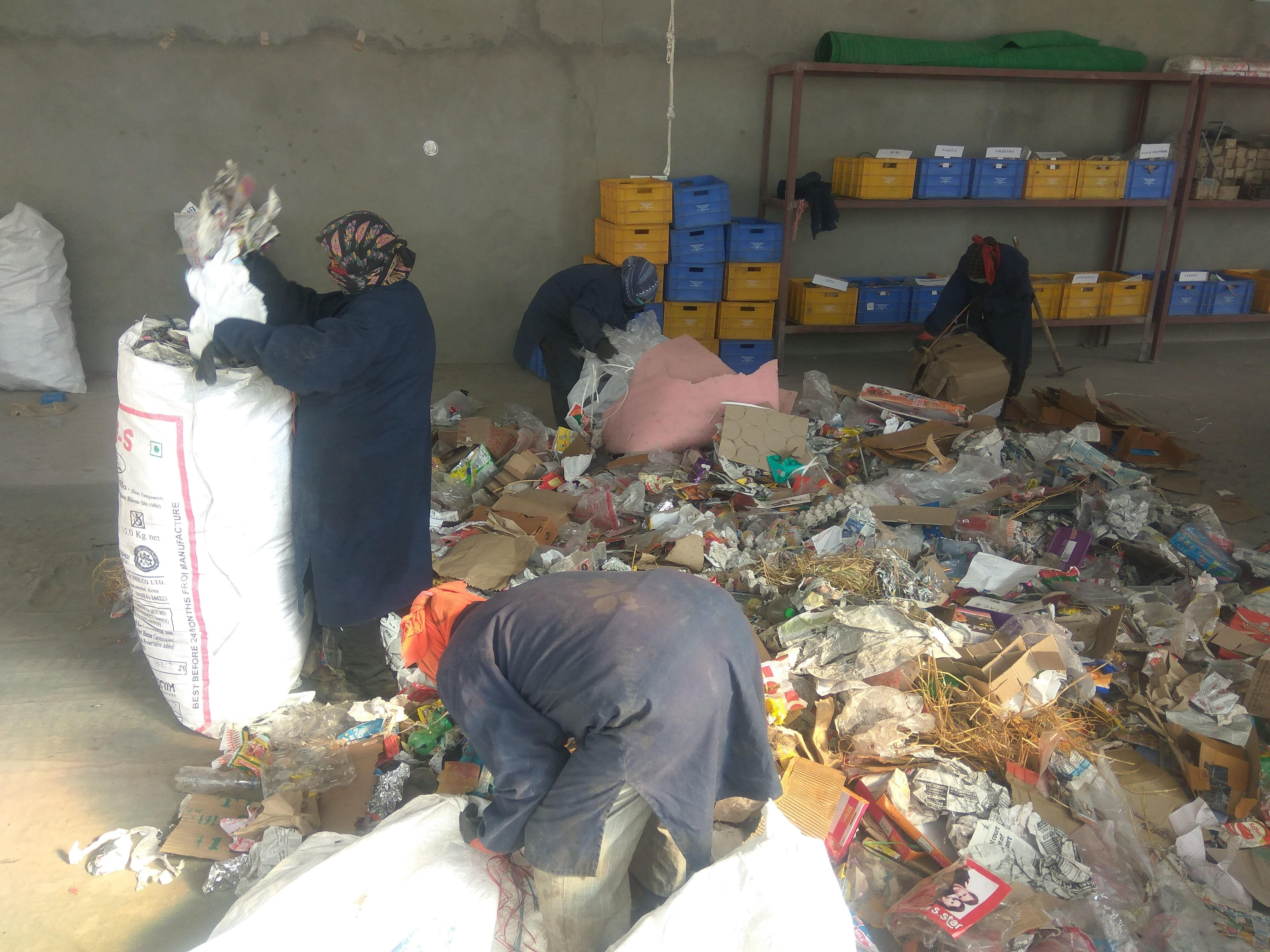 Locals working at the waste segregation centre in Choglamsar. (Source: District Administration Leh)