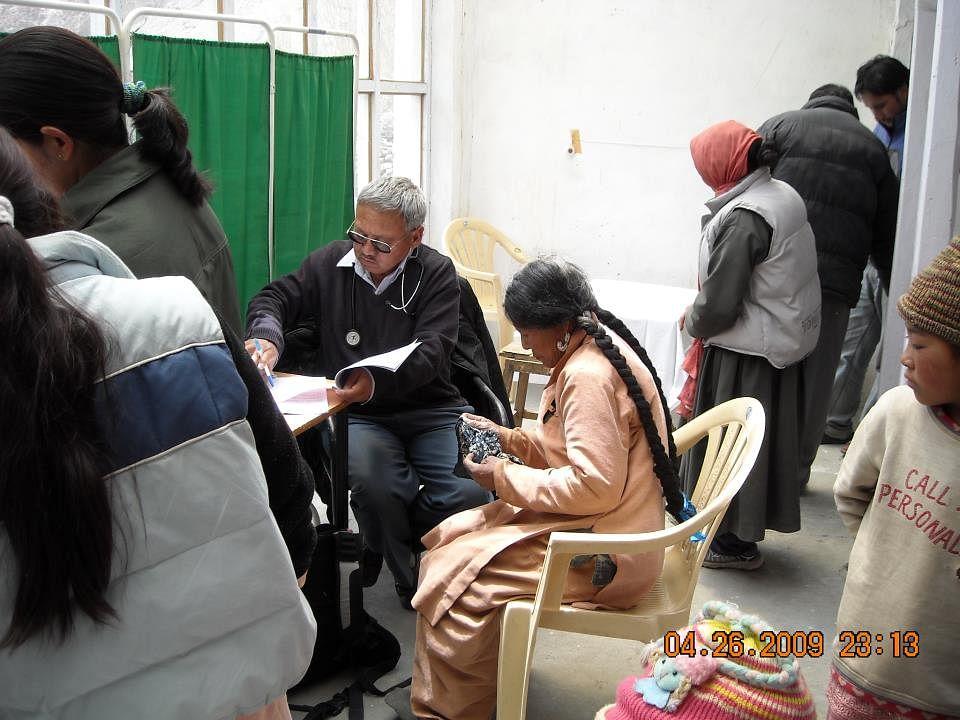 Dr Tsering Norboo writing a prescription for a patient. (Source: Facebook/Ladakh Institute for Prevention)
