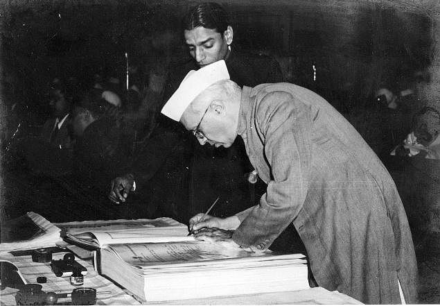 Jawaharlal Nehru signing the Constitution. (Source: Wikimedia Commons)