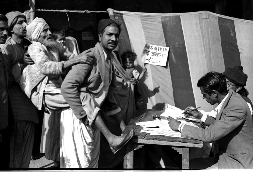 First General Election in India: A blind old man being carried towards a polling booth by his son, to help him to cast his vote, near a polling station in Jama Masjid area in Delhi. (Source: Photodivision.gov.in)