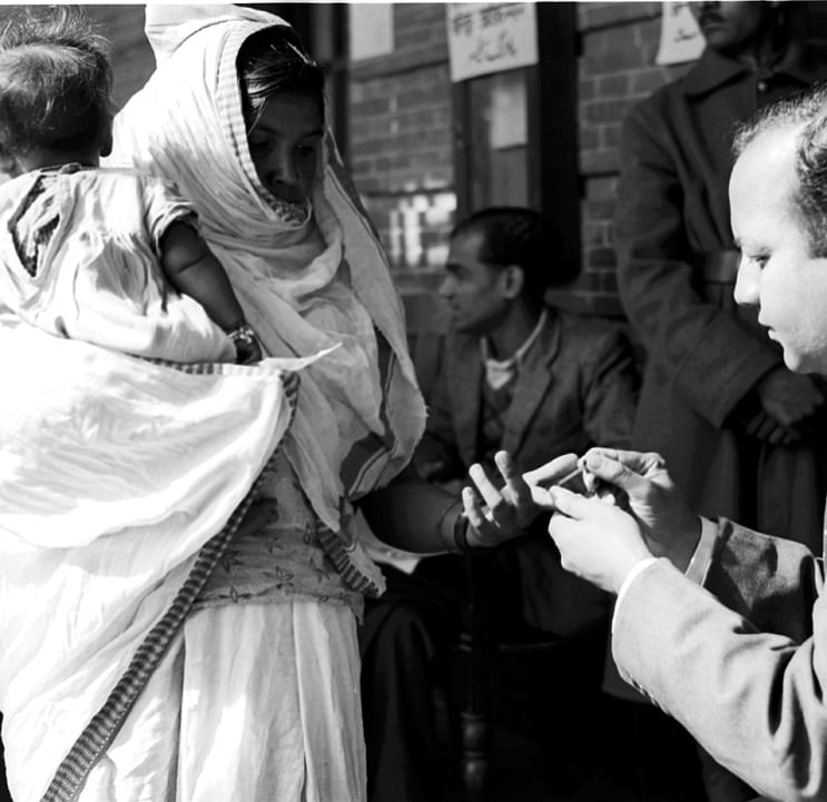 First General Elections (Polling Day in Delhi – January 14, 1952): A Polling Officers affixes indelible ink mark on the fore-finger of a voter before allowing her to cast the vote. (Source: Photodivision.gov.in)