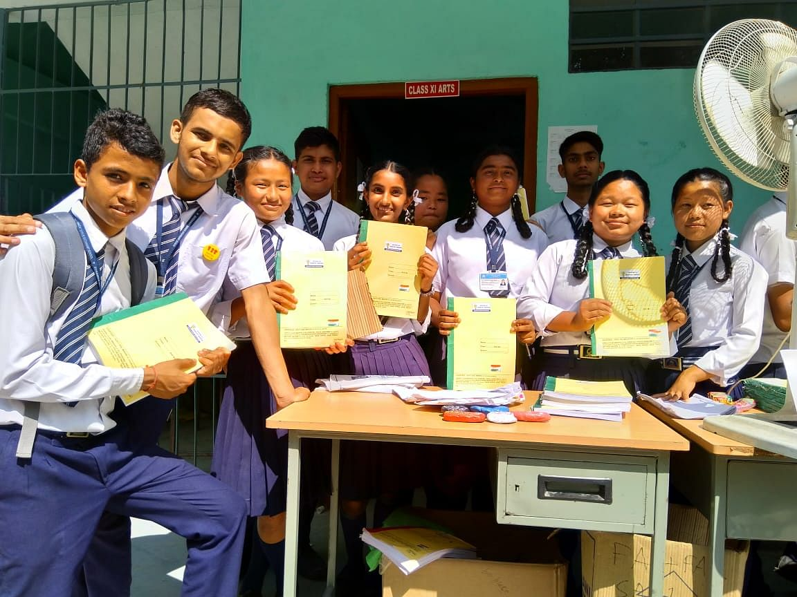 Students of the Government Senior Secondary School in Markha village, Sikkim with their recycled notebooks. (Source: Hariyo Makha- Sikkim Against Air Pollution)