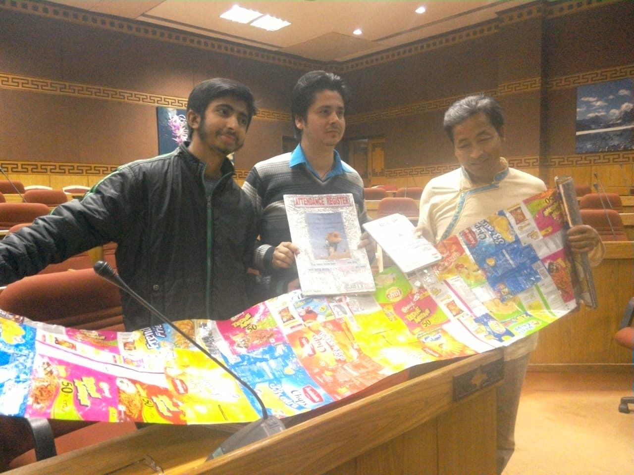 Lomas standing in the middle with the book covers made of plastic chips packets. (Source: Hariyo Makha- Sikkim Against Air Pollution)