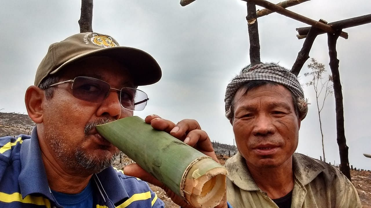 Understanding jhum cultivation. Enjoying a mug of local red tea with a jhum farmer in 2017.