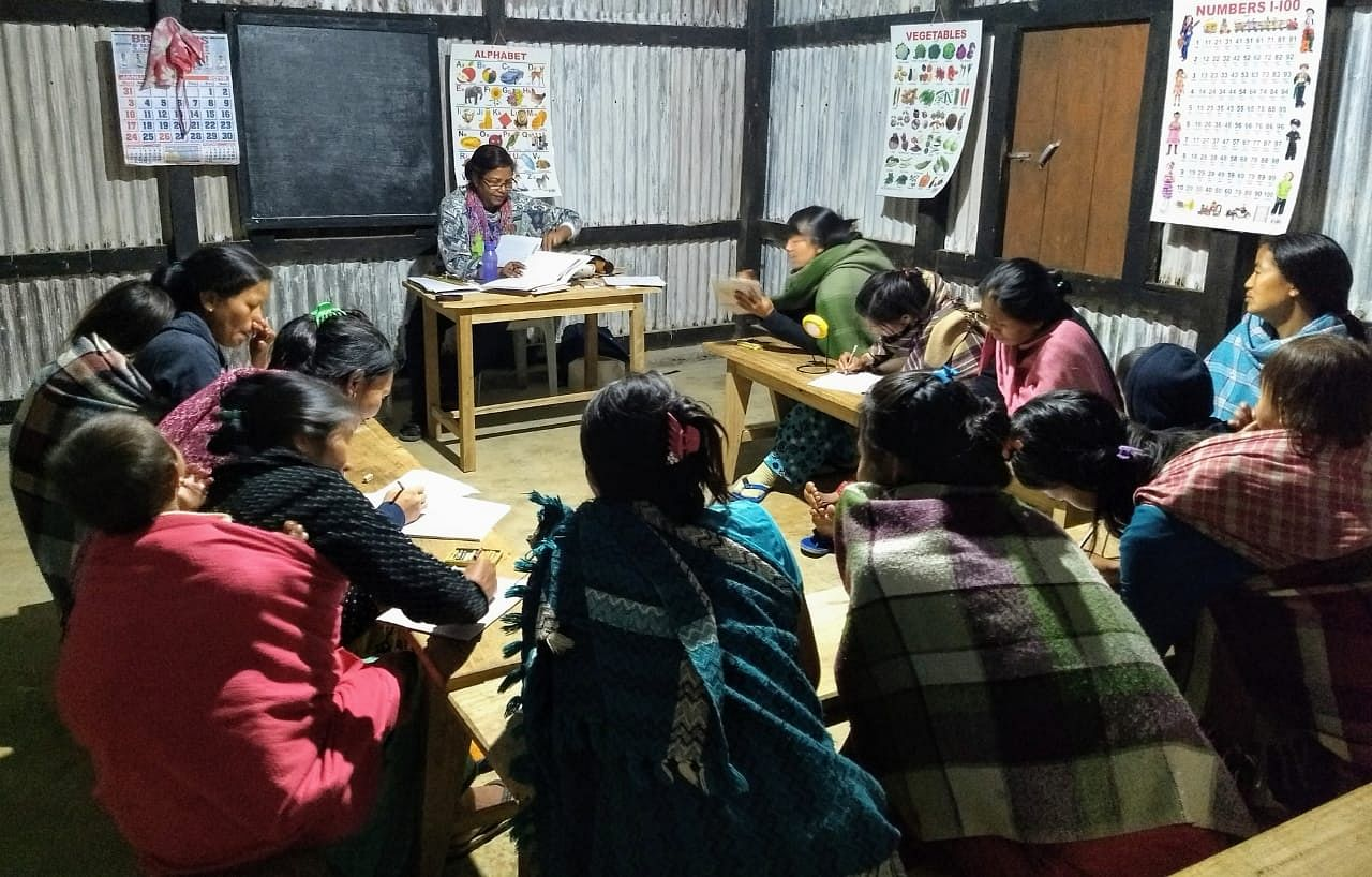 Usha taking evening literacy classes for women at the renovated nursery school building-solar lighting-in November 2018.