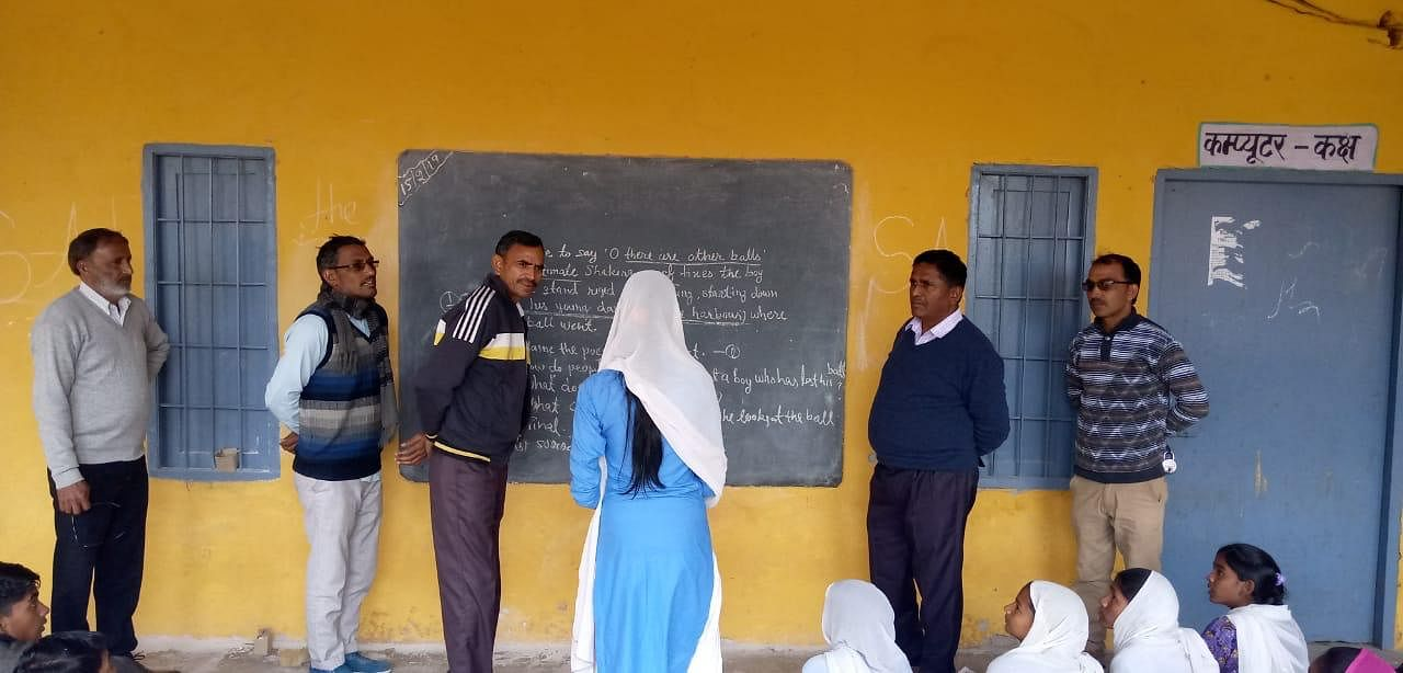 School monitoring visit: Officials on a random inspection.