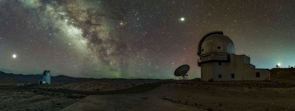 Left to Right are: 1. Mars at Opposition when it is the nearest in 15 years and playing the lead role 2. GROWTH Telescope getting ready in its quest for Transient events. 3. Saturn sitting comfortably near the Milky-Way dark lane. 4. Milky-way. 5. Jupiter towering above the Himalayan Chandra Telescope. 6. Himalayan Chandra Telescope, having already started its quest for understanding of the Universe for the night. 7. Venus setting over National Large Telescope site The occassion was also special since there was planetary alignment of 5 planets with Pluto giving a fleeting/guest apprearance in between Mars and Saturn, not clearly visible in this panorama. Beautiful Red airglow also showing its presence through out the sky. (Source: Dorjey Angchuk)